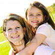 Mother and daughter piggyback — Stock Photo