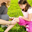 Mother putting bandage on child - Stockfoto