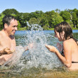 Family splashing in lake — Stock Photo #4719301