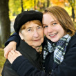 Granddaughter hugging grandmother — Stock Photo #4719304