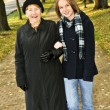 Granddaughter walking with grandmother — Stock Photo
