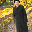 Senior woman in fall park — Stock Photo #4719310
