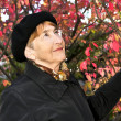 Senior woman in fall park — Stock Photo #4719314