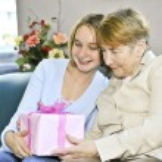 Granddaughter visiting grandmother — Stock Photo