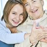 Granddaughter visiting grandmother — Stock Photo #4719359