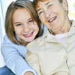 Granddaughter visiting grandmother — Stock Photo