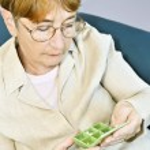 Elderly woman with pill box — Stock Photo #4719375