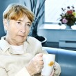 Sad elderly woman - Stock Photo