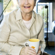 Elderly woman relaxing - Stock Photo