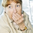 Scared elderly woman - Stock Photo