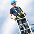 Man working on roof - Stock Photo