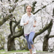 Girl jogging in park — Stock Photo