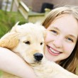 Girl with puppy - Stock Photo