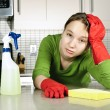 Stock Photo: Tired girl cleaning kitchen