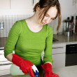 Stock Photo: Girl cleaning kitchen