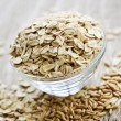 Bowl of uncooked rolled oats — Stock Photo