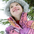 Happy young girl in winter jacket - Stok fotoğraf