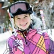 Happy girl in ski helmet at winter resort — Foto de Stock