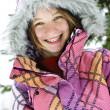 Happy winter girl in ski jacket - Foto Stock