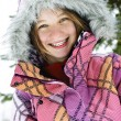 Happy winter girl in ski jacket - Stock Photo