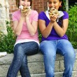 Stock Photo: Girls eating pizza