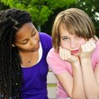 Teenager consoling her friend - Stock Photo