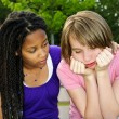 Teenager consoling her friend - Stockfoto