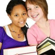 Girls holding text books — Stockfoto