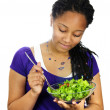 Girl having salad — Stock fotografie