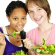 Girls having salad — Stockfoto