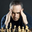 Man at chess board — Stockfoto