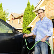Stock Photo: Mwashing car on driveway