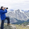 Photographer in mountains — Stock Photo #4719783