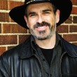 Stock Photo: Bearded man in cowboy hat