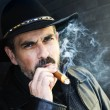 Bearded man smoking cigar — Stockfoto