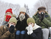 Group of friends with colds outside in winter — Stock Photo