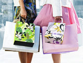 Women holding shopping bags — Stock Photo