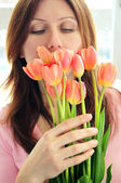 Mature woman with flowers — Stok fotoğraf
