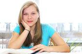 Happy teenage girl studying — Stock Photo