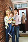 Happy family with real estate agent — Stock Photo