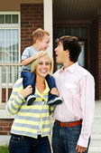 Happy family in front of home — Stock Photo