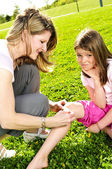 Mother putting bandage on child — Stock Photo