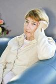 Sad elderly woman — Stock Photo