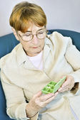 Elderly woman with pill box — Stock Photo
