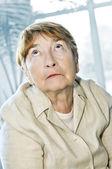 Elderly woman looking up — Stock Photo
