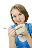 Girl eating cereal — Stock Photo