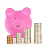 Piggy bank with coin stacks — Stock Photo