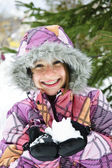 Happy winter girl holding snow — Stock Photo