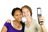 Teen girls with camera phone — Stock Photo