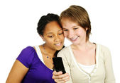 Teen girls with mobile phone — Stock Photo